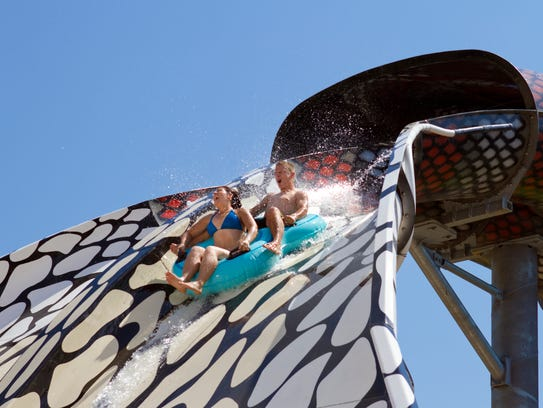 Riders race down the body of a giant snake on the new