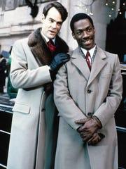 Dan Aykroyd (left) and Eddie Murphy star in the 1983