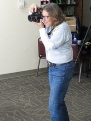 Robyn Wishna, the project director and photographer for We Are Ithaca, takes a photo.