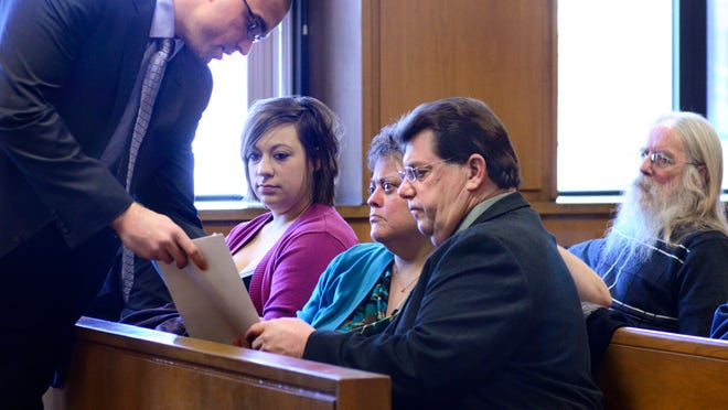 Amanda Amsdill, left, listens as lawyer Matt Newburg, left, speaks with her parents, Debra and Jim Amsdill, during a preliminary examination in 2013. The Michigan Court of Appeals has ruled the Amsdills must stand trial on charges ranging from conducting a criminal enterprise to conspiracy to deliver or manufacture marijuana.