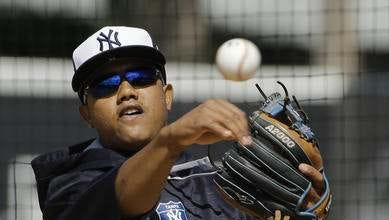 Starlin Castro goes through fielding drills early in spring training.