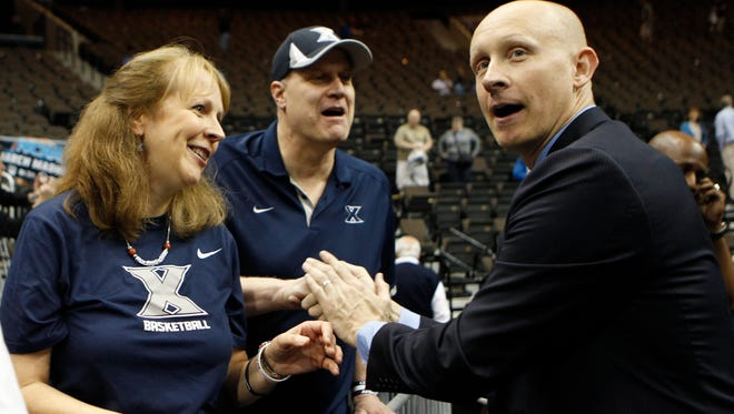 Xavier head coach Chris Mack greets fans after the Musketeers beat Ole Miss on Thursday in Jacksonville.