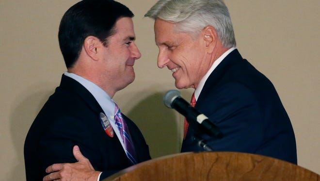 Arizona Democratic gubernatorial candidate Fred DuVal (right) and Republican candidate Doug Ducey greet each other on Oct 13, 2014, during a debate for the Arizona Women's Forum in Paradise Valley.
