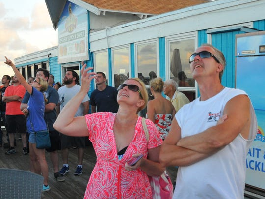Kim Conley and Steve Bruce watch the launch from the Cocoa Beach Pier.