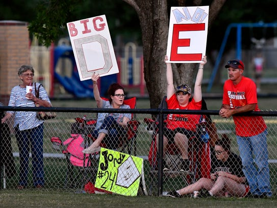 Colorado High School softball fans cheer on the Lady Wolves during Friday's game in Hawley. The Lady Wolves won their three-game series against Eastland in Round 2 of the Region 1 3A playoffs.