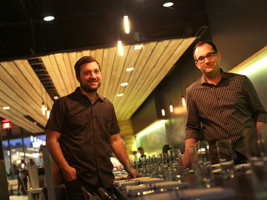 Selden Standard's executive chef and co-owner Andy Hollyday, left, and co-owner Evan Hansen are photographed in their flagship restaurant.