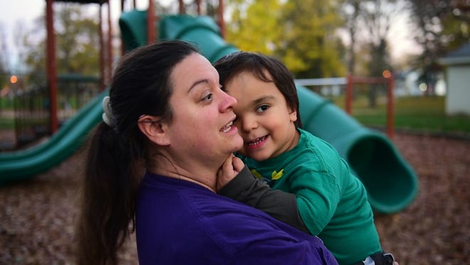 Malinda Fisher of Fremont with her son, Ayden Wilson, 5, who was born with achondroplasia, a form of short-limbed dwarfism. His torso is average size with shortened legs.