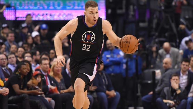 Los Angeles Clippers forward Blake Griffin (32) dribbles the ball against the Toronto Raptors at Air Canada Centre.