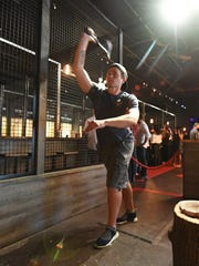 Roland Zilberman, an Axpert at Kick Axe, a Brooklyn-based ax-throwing bar.