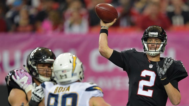 Atlanta Falcons quarterback Matt Ryan (2) passes over San Diego Chargers defensive end Joey Bosa (99) during the second half at the Georgia Dome. The Chargers defeated the Falcons 33-30 in overtime.