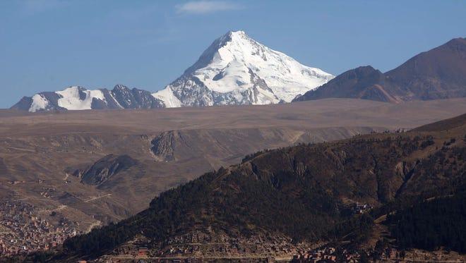The 6,010-meter Huayna Potosi is seen above La Paz, Bolivia.