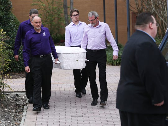 The casket of Phoebe Jonchuck is carried out Jan. 14,