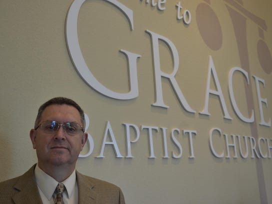 Pastor Rick Bickelhaupt stands in his church, which