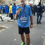 Kevin Shaw shows his medal at the completion of the physical challenge and cultural experience of the New City Marathon Nov. 1.