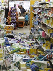Debris covers the floor of the Miller's Mart food store in Mineral, Va., a small town northwest of Richmond near the 2011 earthquake's epicenter.