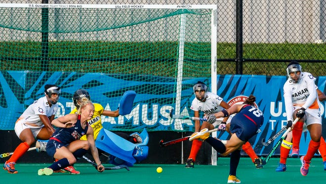 United States forward Michelle Kasold (18) sends a penalty corner to fellow forward and Lancaster native Jill Witmer, who scored the first goal in Wednesday's match against India at Spooky Nook Sports in Lancaster County. India went on to earn a 2-1 victory. The U.S. national field hockey team will play its final match on U.S. soil before the Olympics on Tuesday, July 26.