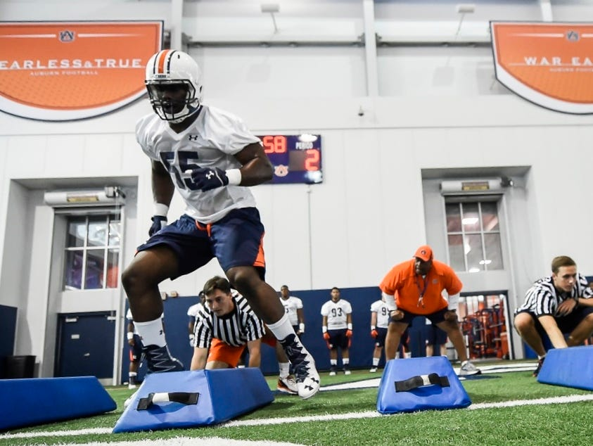 Pro Football Focus projects Carl Lawson to go in the first round of next month's NFL Draft.