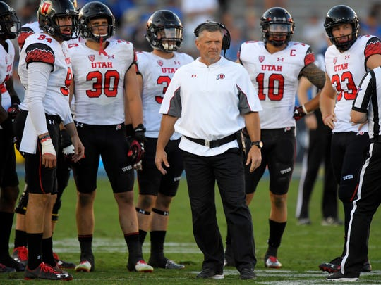 Utah head coach Kyle Whittingham stands with members of his team during a game against UCLA in 2016. The Utes were picked to finish second in South Division in the Pac-12 preseason media poll on Wednesday.