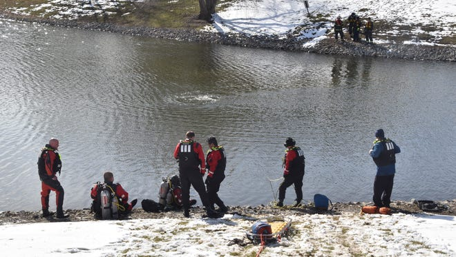 A 24-year-old and his 3-year-old daughter were in critical condition Sunday, March 25, 2018, after a car the girl was in rolled into a north-side retention pond.