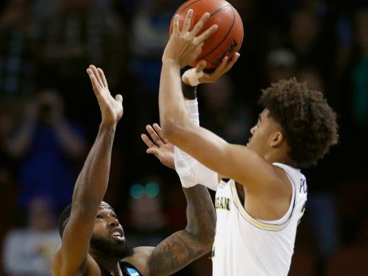 AP NCAA-MICHIGAN-POOLE SHOT BASKETBALL S BKC FILE USA KS