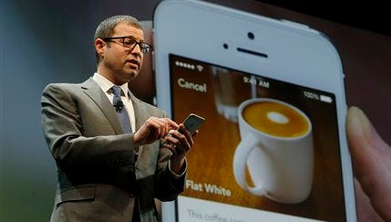 FILE - In this March 18, 2015 file photo, Adam Brotman, Starbucks chief digital officer, talks about the company's new mobile ordering app at Starbucks Coffee Company's annual shareholders meeting in Seattle. The Seattle-based coffee chain says its mobile app that lets people order and pay in advance will be available nationally starting Tuesday, Sept. 22, 2015. (AP Photo/Ted S. Warren, File)