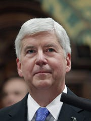 A federal judge has ruled that an amended class-action lawsuit against former Gov. Rick Snyder over the Flint water crisis can proceed.
