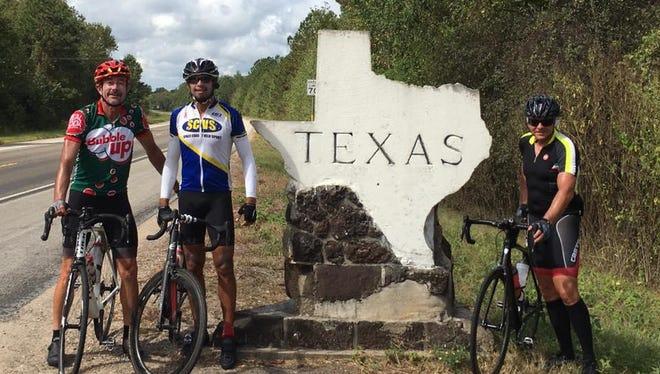 From left, Don Hemmenway, Matt Kerr and John Fahnestock pause for a photo at the border of Texas and Louisiana.