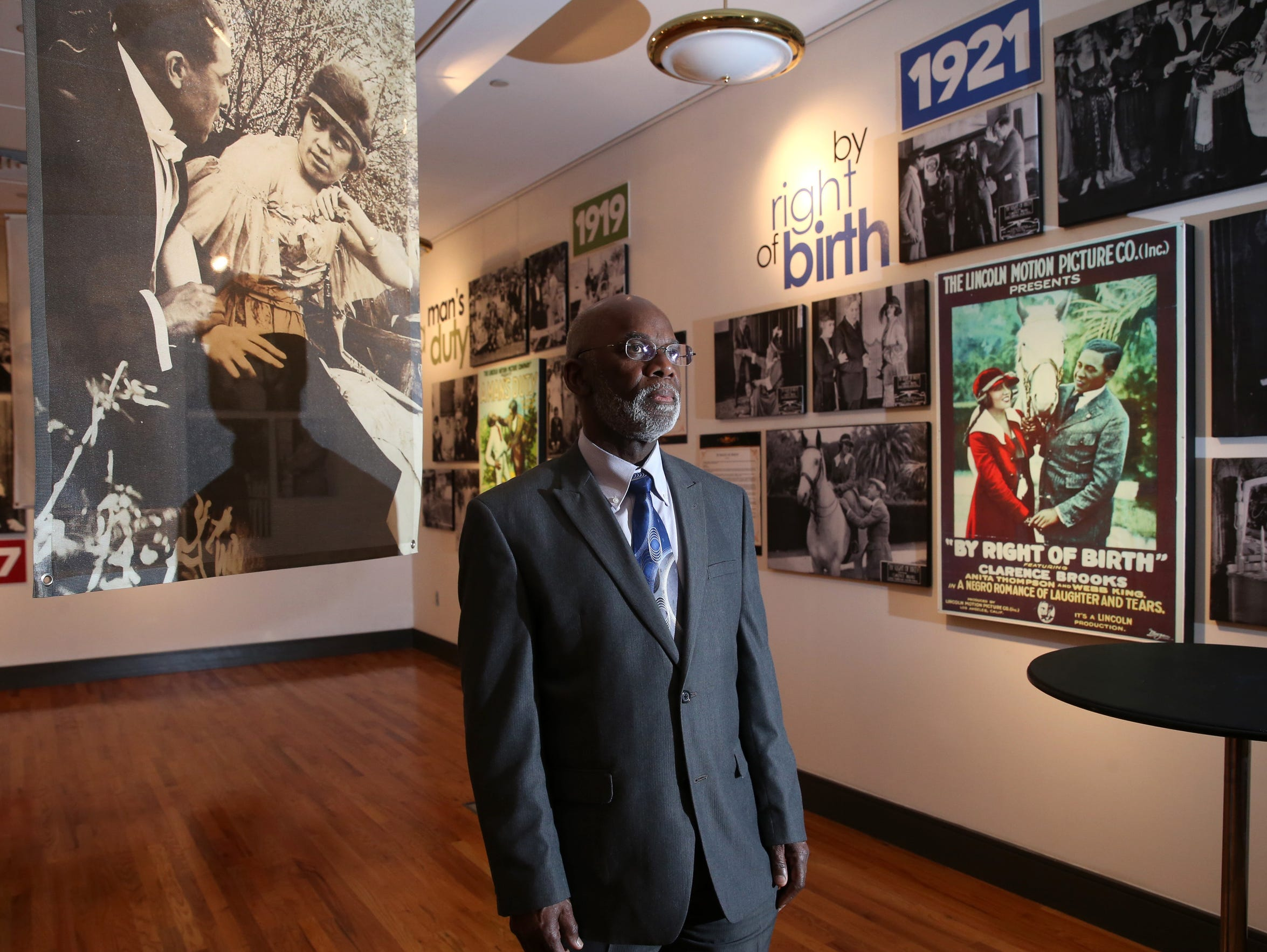 Clint Byrd stands amongst the memorabilia from the