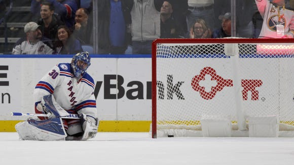 New York Rangers goalie Henrik Lundqvist reacts after letting in a goal during the third period against the Buffalo Sabres at KeyBank Center Thursday night. The Sabres beat the Rangers 4-3.