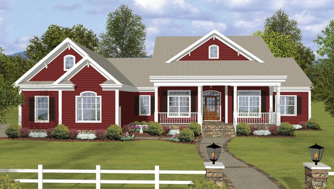 The wide front porch and discreet side-facing garage give this exterior a country vibe.