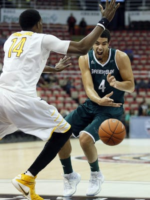 Green Bay's Jordan Fouse (4) bounce passes the ball against Valparaiso's Vashil Fernandez (14) during the first half of a NCAA college basketball game in the Horizon League tournament Monday, March 7, 2016, in Detroit. (AP Photo/Duane Burleson)