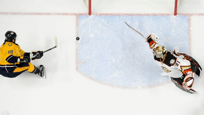 Nashville Predators right wing James Neal (18) scores a goal past Anaheim Ducks goalie Frederik Andersen (31) during the second period of Game 6 of an NHL hockey first-round Stanley Cup playoff series at the Bridgestone Arena, Monday, April 25, 2016, in Nashville, Tenn.