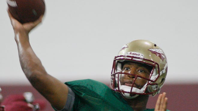 Florida State quarterback Jameis Winston (5) throws during an afternoon practice at their indoor training facility following NCAA college football media day on Sunday, Aug. 11, 2013, in Tallahassee, Fla. (AP Photo/Phil Sears)