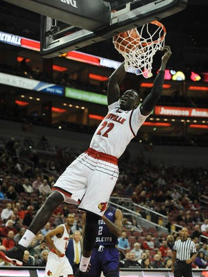 Louisville's Deng Adel (22) dunks against Kentucky Wesleyan on Monday at the KFC Yum! Center. Oct. 30, 2017