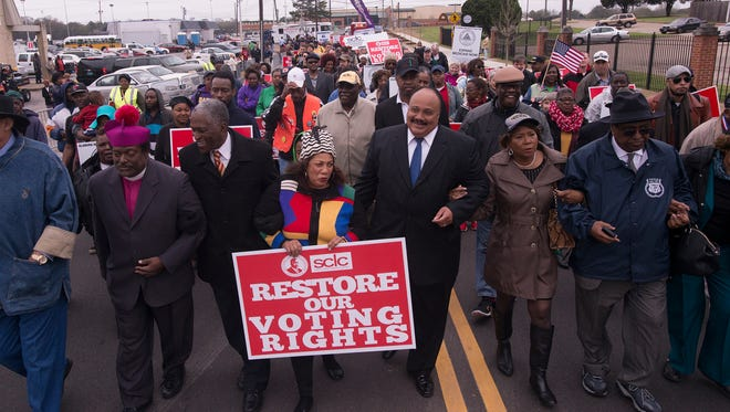 From left, Thomas Masters, Mayor of Riviera, Fla., Johnny Ford, Mayor of Tuskegee, Sheyann Webb Christburg, Martin Luther King III, Cathelean Steele and Charles Steele, march during the final day of marching of the SCLC March from Selma to Montgomery on Friday, March 13, 2015, in Montgomery, Ala. The march was organized by the Southern Christian Leadership Conference.