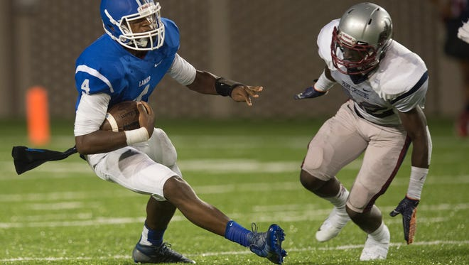 Lanier's James Foster runs with the ball during the AHSAA game between Park Crossing High School and Lanier High School on Friday, Aug. 28, 2015.