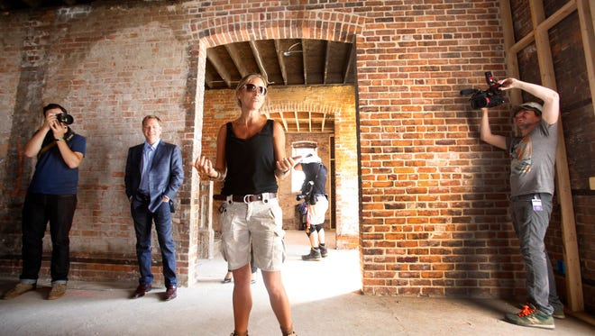 HGTV host Nicole Curtis of the show Rehab Addict gives the media a tour of the Ransom Gillis mansion in Detroit's Brush Park district on Thursday, August 6, 2015. The renovation of the historic mansion will be featured in a series featuring Curtis in November on HGTV.