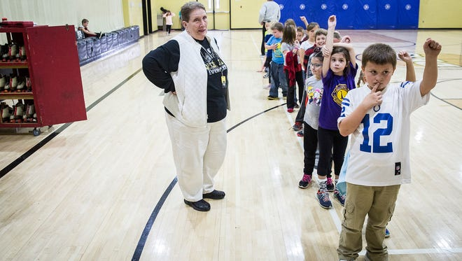 Mary Smith, 82, volunteers during a gym class at Daleville Elementary School Friday afternoon.