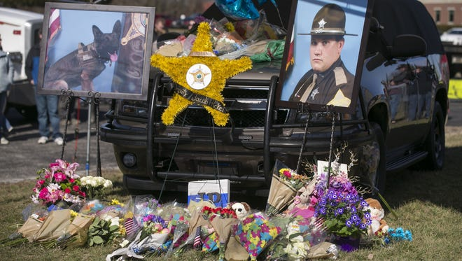 The car of Deputy Jacob Pickett, utside the Boone County Sheriff's Office and Jail, home office of Pickett, Lebanon, Saturday, March 3, 2018. The deputy was fatally shot a day earlier while helping local police serve a warrant.