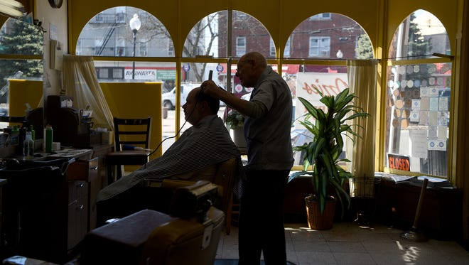 """Oswald """"Ozzie,"""" Chiarella puts the finishing touches on a haircut for Dean Despotovich on Thursday, March 15, 2018. Despotovich has been coming to Ozzie's Barber Shop in Clifton's Botany Village for over twenty years. This will be his last haircut with Ozzie who will retire on Saturday after cutting hair for sixty-eight years."""
