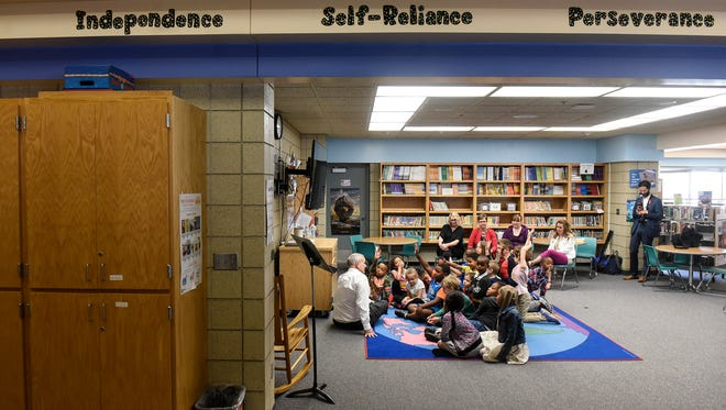 Gov. Mark Dayton speaks with Talahi Community School students Thursday, May 10, in St. Cloud during a tour to promote his proposal for emergency school aid.