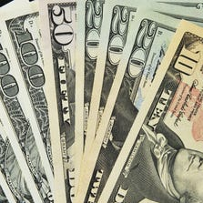 A close-up photo showing of the front of various US bank notes.
