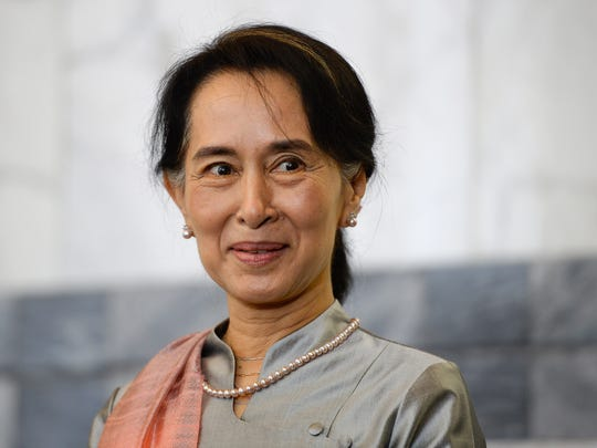 Aung San Suu Kyi, Myanmar's Nobel Peace Prize laureate and former long-time political prisoner smiles as she arrives for a meeting in Rome, Oct. 28, 2013.