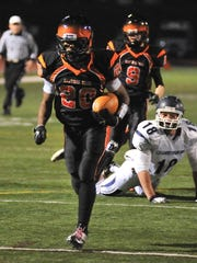 Central York's Sherief Sutton breaks free for a touchdown Friday night during the Panthers' 33-28 win vs. Chambersburg. (For the Daily Record/Sunday News -- Mike Zortman)