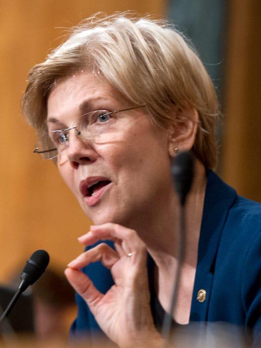 Elizabeth Warren calls on Fed to remove Wells Fargo board members over account scandal