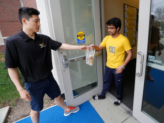 HungryBoiler driver Eric Koo, left, delivers two bubble