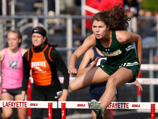 Kayla Schluttenhofer of Benton Central takes the girls 100 meter hurdles with a time of 15:65 during the Hoosier Conference Track and Field Championships Tuesday, May 9, 2017, at West Lafayette. Schluttenhofer's time is a new conference record.