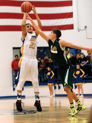 Bloomfield's Malachi Pablo shoots a three-pointer in a game against Thoreau on March 2 at Bobcat Gym in Bloomfield.