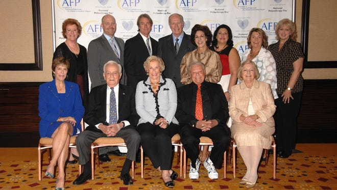 Standing (left to right)  Sarah G. Clapp, President of the Association of Fundraising Professionals CA, Desert Communities Chapter, Honoree David Herrlinger, Honoree Nate Otto, Honoree Dr. James Brinton, Honoree Terri Bona, Eve Bromberg representing Honoree Palm Springs Pathfinders , Vickie Culver, President of Pathfinders, Judi Olivas, Event Chair of National Philanthropy Day.  Seated Row (left to right) Honoree Connie Golds, Honoree Harry Goldstein, Honoree Joy Goldstein, Presenting Sponsor and Honorary Chair of National Philanthropy Day Harold Matzner, and Honoree Lorraine Brinton