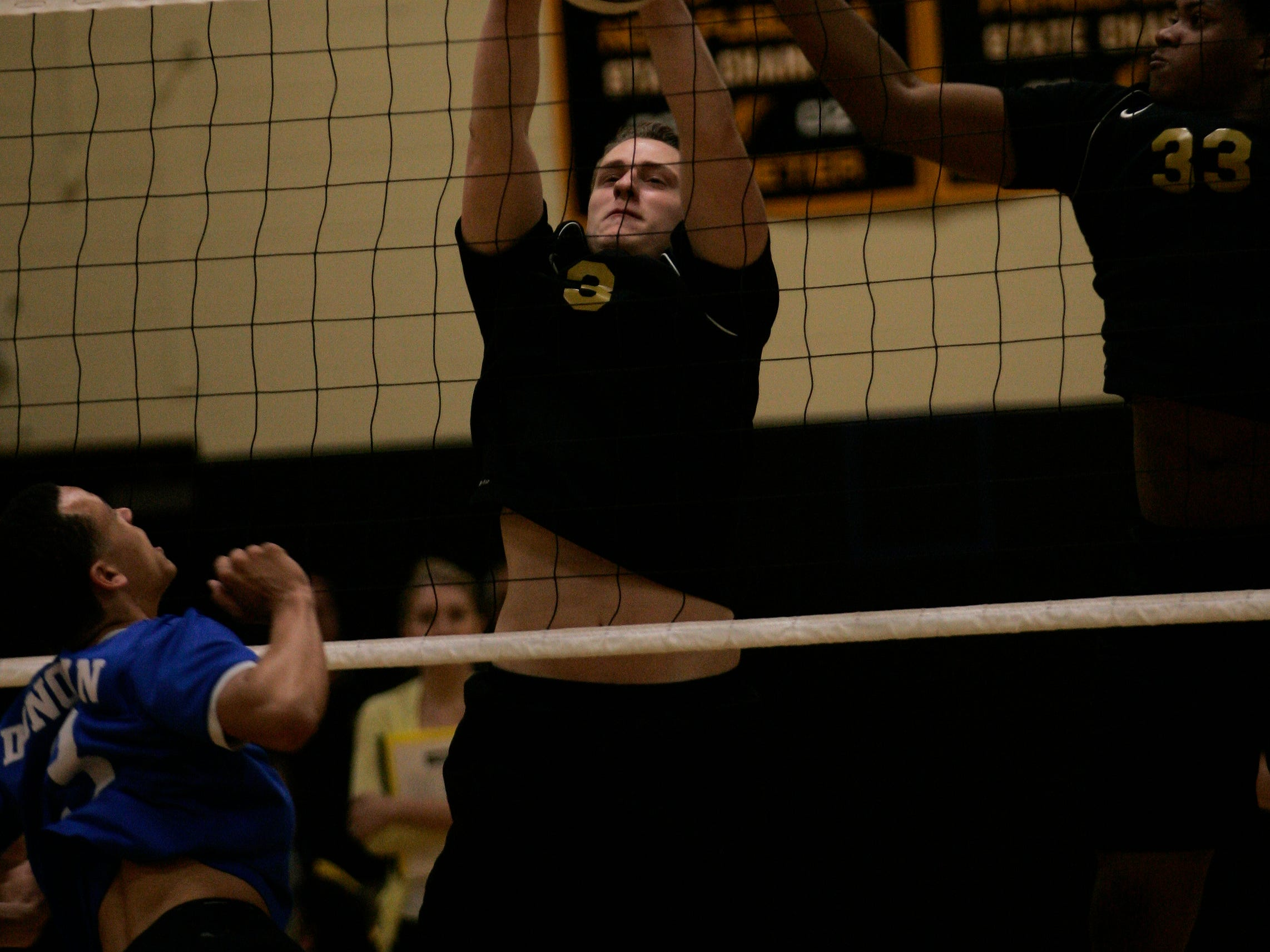 St. John Vianney 's Michael McGimpsey (RIGHT) blocks a shot by Monsignor Donovan in the first game of a Shore Conference Tournament match, in Aberdeen, Wednesday, May 13, 2015, Jerry Wolkowitz/Correspondent ASB 0514 Donovan Catholic at SJV SCT volleyball 051315